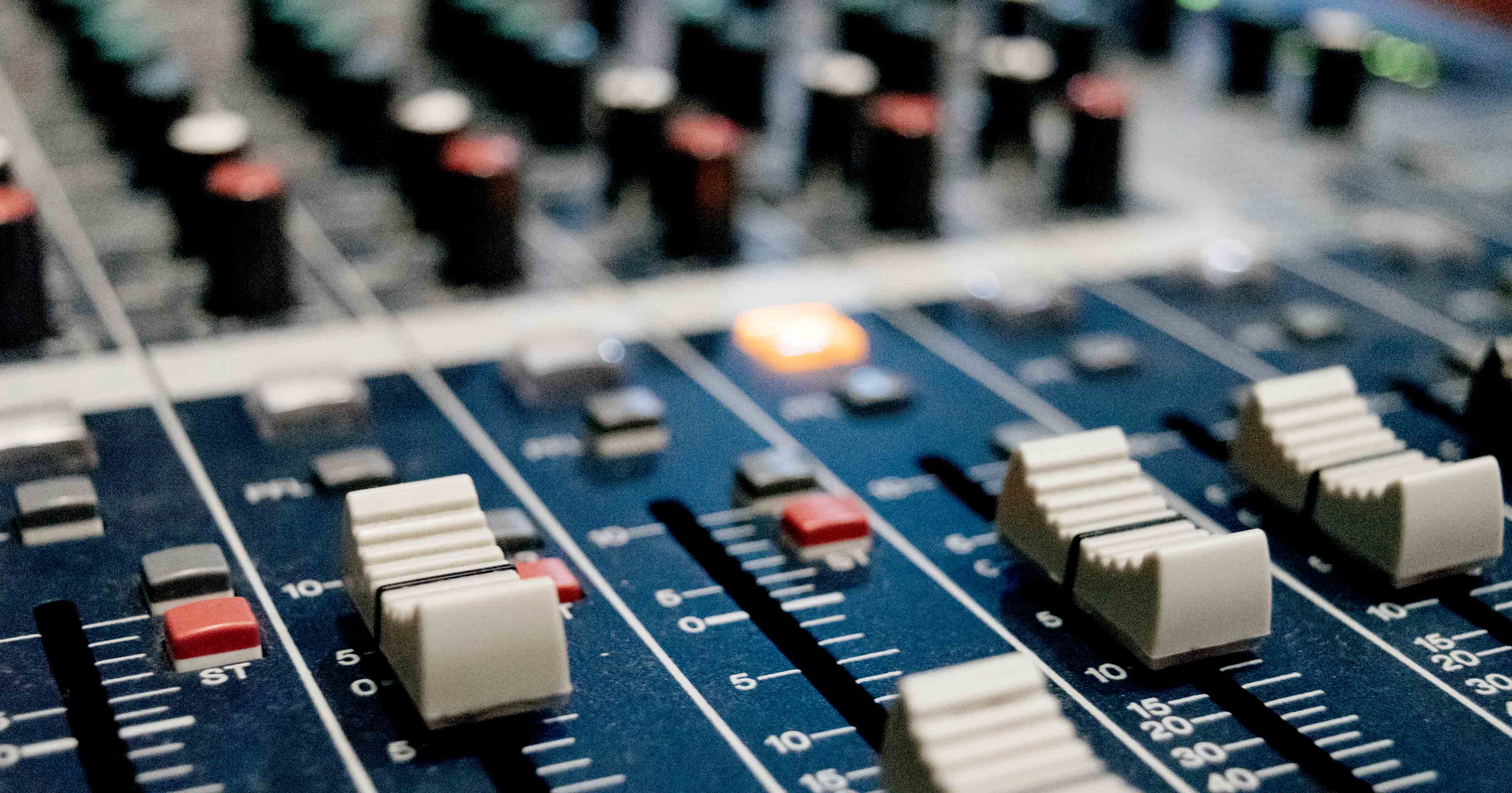 Image of an audio mixing desk
